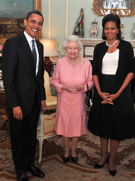 US President Barack Obama (L) and his wife Michelle (R)  meet Britain's Queen Elizabeth II (C) during an audience at Buckingham Palace in central London, on April 1, 2009. US President Barack Obama visited Queen Elizabeth II at Buckingham Palace on Wednesday while his in London for the G20 summit. Obama and wife Michelle were hosted by the queen for a meeting, the day before the crunch summit on tackling the world economic crisis. AFP PHOTO/John Stillwell/WPA POOL (Photo credit should read JOHN STILLWELL/AFP/Getty Images